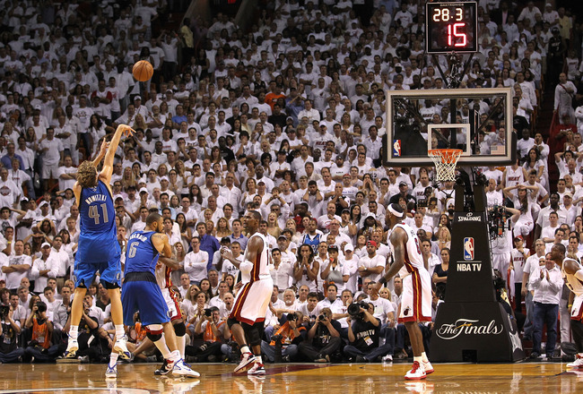 MIAMI, FL - JUNE 02:  Dirk Nowitzki #41 of the Dallas Mavericks shoots and makes a 3-point shot in the final 30 seconds of the fourth quarter to put the Mavericks up 93-90 against the Miami Heat n Game Two of the 2011 NBA Finals at American Airlines Arena