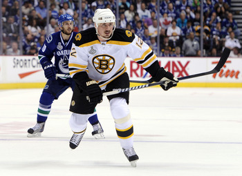 VANCOUVER, BC - JUNE 01:  Tomas Kaberle #12 of the Boston Bruins skates against Jeff Tambellini #10 of the Vancouver Canucks during game one of the 2011 NHL Stanley Cup Finals at Rogers Arena on June 1, 2011 in Vancouver, Canada.  (Photo by Harry How/Gett