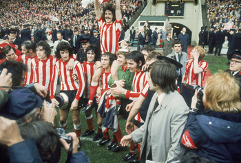 LONDON - MAY 5:  Bobby Kerr of Sunderland lifts the cup as he is lifted up by his team-mates after the FA Cup Final between Sunderland and Leeds United held on May 5, 1973 at Wembley Stadium, in London. Sunderland won the match and cup 1-0. (Photo by Gett