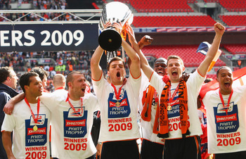LONDON - APRIL 05: Chris Martin (C) with the trophy with team mates after victory during the Johnstone's Paint Trophy Final match between Luton Town and Scunthorpe United at Wembley Stadium on April 5, 2009 in London, England.  (Photo by Phil Cole/Getty I