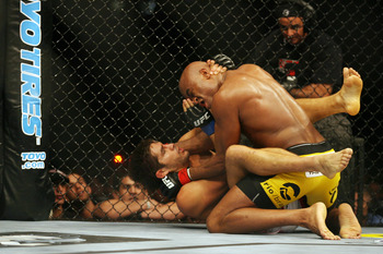 CHICAGO- OCTOBER 25:  Anderson Silva (R) fights Patrick Cote in the Middleweight Title Bout at UFC's Ultimate Fight Night at Allstate Arena on October 25, 2008 in Chicago, Illinois. (Photo by Tasos Katopodis/Getty Images)