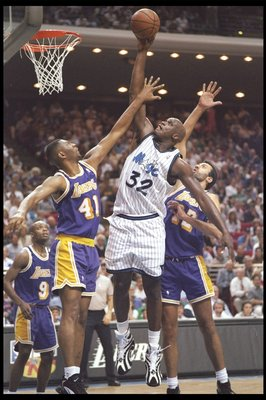 26 Mar 1996: Center Shaquille O''Neal of the Orlando Magic fights for a rebound with center Vlade Divac and forward Eldon Campbell of the Los Angeles Lakers at the Orlando Arena in Orlando, Florida. The Lakers won the game 113-91.