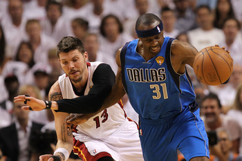 MIAMI, FL - JUNE 02:  Jason Terry #31 of the Dallas Mavericks puses the ball up court against Mike Miller #13 of the Miami Heat in Game Two of the 2011 NBA Finals at American Airlines Arena on June 2, 2011 in Miami, Florida. NOTE TO USER: User expressly a
