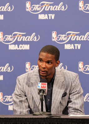 MIAMI, FL - JUNE 02:  Chris Bosh #1 of the Miami Heat answers questions from the media during a post game press conference after the Heat lost 95-93 against the Dallas Mavericks in Game Two of the 2011 NBA Finals at American Airlines Arena on June 2, 2011