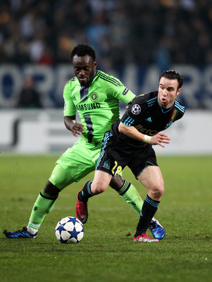 MARSEILLE, FRANCE - DECEMBER 08:  Michael Essien of Chelsea and Mathieu Valbuena of Marseille compete for the ball during the UEFA Champions League Group F match between Marseille and Chelsea at the Stade Velodrome on December 8, 2010 in Marseille, France