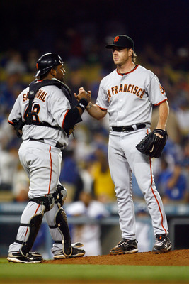 LOS ANGELES, CA - MAY 08:  Pitcher Brian Wilson (L) #38 of the San Francisco Giants is congratulated by catcher Pablo Sandoval #48 after saving the game against the Los Angeles Dodgers at Dodger Stadium on May 8, 2009 in Los Angeles, California. The Giant