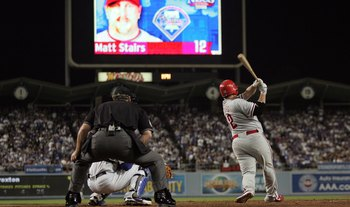 LOS ANGELES, CA - OCTOBER 13:  Matt Stairs #12 of the Philadelphia Phillies hits a two-run pinch hit home run in the eighth inning off Jonathan Broxton #51 of the Los Angeles Dodgers to take a two-run lead in game Game Four of the National League Champion