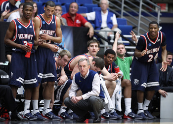 Rick Byrd and his team look on during the first round game vs Wisconsin