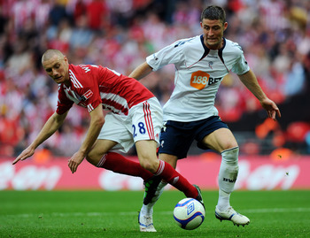 LONDON, ENGLAND - APRIL 17:  Andy Wilkinson of Stoke is challenged by Gary Cahill of Bolton during the FA Cup sponsored by E.ON semi final between match Bolton Wanderers and Stoke City at Wembley Stadium on April 17, 2011 in London, England.  (Photo by Mi