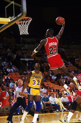 Michael Jordan #23 of the Chicago Bulls dunks the ball during a game against the Los Angeles Lakers.