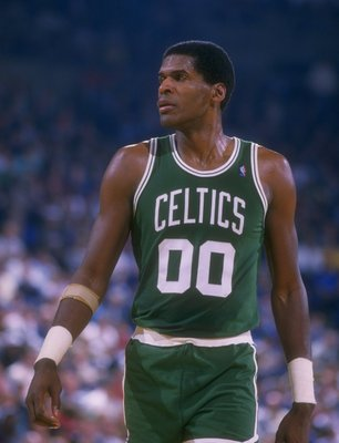 Robert Parish of the Boston Celtics looks on during a game.