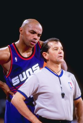 1992-1993:  Forward Charles Barkley of the Phoenix Suns confers with an official during a game against the Denver Nuggets at McNichols Arena in Denver, Colorado. Mandatory Credit: Tim DeFrisco  /Allsport