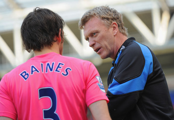 WIGAN, ENGLAND - APRIL 30: Everton manager David Moyes speaks to his player Leighton Baines before the Barclays Premier League match between Wigan and Everton at the DW Stadium on April 30, 2011 in Wigan, England.  (Photo by Michael Regan/Getty Images)
