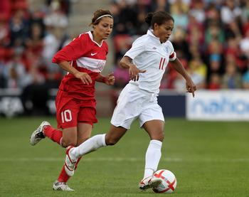 WALSALL, ENGLAND - JULY 29:  Rachel Yankey of England races away from Eylul Elgalp during the FIFA Womens World Cup Qualifiying match between England and Turkey at the Banks's Stadium on July 29, 2010 in Walsall, England.  (Photo by David Rogers/Getty Ima