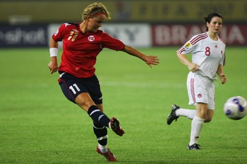 HANGZHOU, CHINA - SEPTEMBER 12:  Leni Larsen Kaurin of Norway fires in a shot  during the FIFA Women's World Cup 2007 Group C match between Norway and Canada at Hangzhou Dragon Stadium on September 12, 2007 in Hangzhou, Zhejiang province of China. (Photo