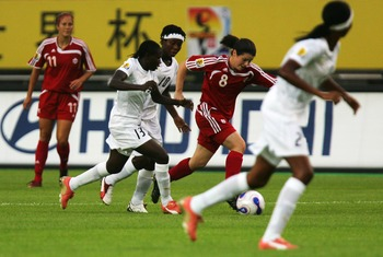 HANGZHOU, ZHEJIANG - SEPTEMBER 15:  Diana Matheson #8 of Canada battles for the ball with Yaa Avoe #13# and Adjoa Bayor #10 of Ghana during the FIFA Women's World Cup 2007 Group C match between Canada and Ghana at Hangzhou Dragon Stadium on September 15,