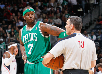 ATLANTA, GA - APRIL 01:  Jermaine O'Neal #7 of the Boston Celtics converses with referee Monty McCutchen #13 against the Atlanta Hawks at Philips Arena on April 1, 2011 in Atlanta, Georgia.  NOTE TO USER: User expressly acknowledges and agrees that, by do