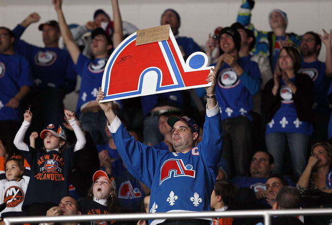 UNIONDALE, NY - DECEMBER 11:  Members of 'Nordiques Nation' cheer during the NHL game between the New York Islanders and the Atlanta Thrashers on December 11, 2010 at Nassau Coliseum in Uniondale, New York.  Over 1,100 fans from Quebec attended the game t