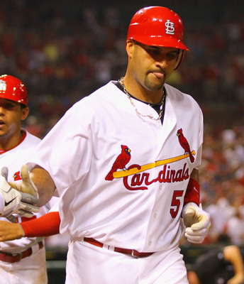 ST. LOUIS, MO - JUNE 3: Albert Pujols #5 of the St. Louis Cardinals celebrates after hitting a two-run home run against the Chicago Cubs at Busch Stadium on June 3, 2011 in St. Louis, Missouri.  (Photo by Dilip Vishwanat/Getty Images)