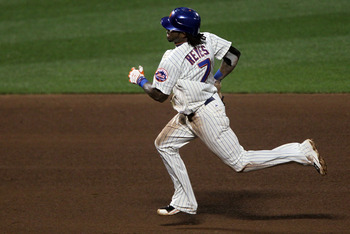 NEW YORK - AUGUST 14:  Jose Reyes #7 of the New York Mets runs the bases after during his triple against the Philadelphia Phillies on August 14, 2010 at Citi Field in the Flushing neighborhood of the Queens borough of New York City.  (Photo by Jim McIsaac