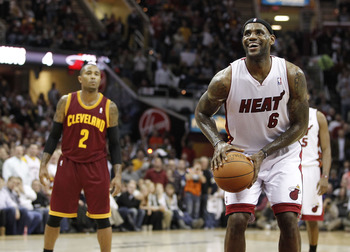 CLEVELAND, OH - DECEMBER 02:  LeBron James #6 of the Miami Heat smiles while takeing a free throw in front of Mo Williams #2 of the Cleveland Cavaliers at Quicken Loans Arena on December 2, 2010 in Cleveland, Ohio. NOTE TO USER: User expressly acknowledge