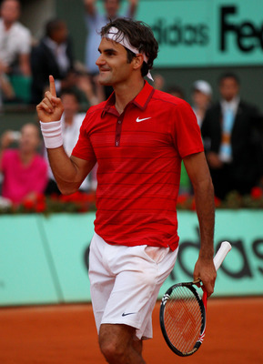 PARIS, FRANCE - JUNE 03:  Roger Federer of Switzerland celebrates match point during the men's singles semi final match between Roger Federer of Switzerland and Novak Djokovic of Serbia  on day thirteen of the French Open at Roland Garros on June 3, 2011