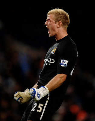 MANCHESTER, ENGLAND - MAY 10:  Joe Hart of Manchester City celebrates at the end of the Barclays Premier League match between Manchester City and Tottenham Hotspur at the City of Manchester Stadium on May 10, 2011 in Manchester, England.  (Photo by Lauren