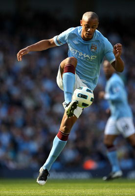 MANCHESTER, ENGLAND - MAY 01:  Vincent Kompany of Manchester City in action during the Barclays Premier League match between Manchester City and West Ham United at the City of Manchester Stadium on May 1, 2011 in Manchester, England. (Photo Alex Livesey/G