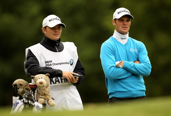 VIRGINIA WATER, ENGLAND - MAY 28:  Martin Kaymer of Germany waits with his caddie on the 6th hole during the third round of the BMW PGA Championship at the Wentworth Club on May 28, 2011 in Virginia Water, England.  (Photo by Ian Walton/Getty Images)