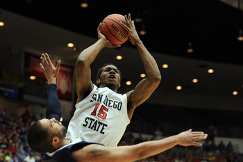 TUCSON, AZ - MARCH 17:  Kawhi Leonard #15 of the San Diego State Aztecs shoots over Taylor Montgomery #44 of the Northern Colorado Bears during the second round of the 2011 NCAA men's basketball tournament at McKale Center on March 17, 2011 in Tucson, Ari