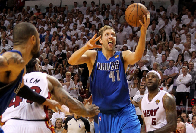 MIAMI, FL - JUNE 02:  Dirk Nowitzki #41 of the Dallas Mavericks makes the game-winning shot to put the Mavericks up 95-93 with 3.6 seconds left in the game against Udonis Haslem #40 of the Miami Heat in Game Two of the 2011 NBA Finals at American Airlines