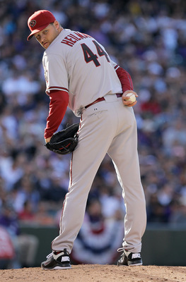 DENVER, CO - APRIL 01:  Relief pitcher Aaron Heilman #44 of the Arizona Diamondbacks works against the Colorado Rockies during Opening Day at Coors Field on April 1, 2011 in Denver, Colorado. The Diamondbacks defeated the Rockies 7-6 in 11 innings.  (Phot