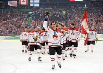 VANCOUVER, BC - FEBRUARY 28:  Team Captain Scott Niedermayer #27 of Canada waves to the fans after receiving the gold medal following his team's 3-2 overtime victory in the ice hockey men's gold medal game against USA on day 17 of the Vancouver 2010 Winte