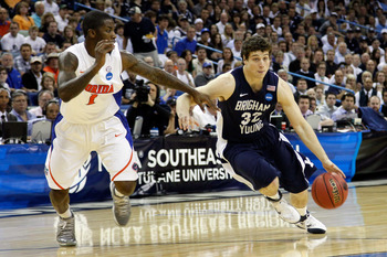 NEW ORLEANS, LA - MARCH 24:  Jimmer Fredette #32 of the Brigham Young Cougars drives against Kenny Boynton #1 of the Florida Gators during the Southeast regional of the 2011 NCAA men's basketball tournament at New Orleans Arena on March 24, 2011 in New Or