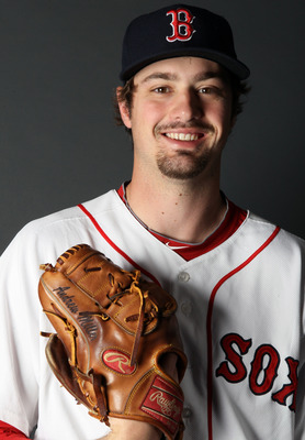 FT. MYERS, FL - FEBRUARY 20:  :  Andrew Miller #30 of the Boston Red Sox poses for a portrait during the Boston Red Sox Photo Day on February 20, 2011 at the Boston Red Sox Player Development Complex in Ft. Myers, Florida  (Photo by Elsa/Getty Images)