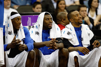 KANSAS CITY, MO - MARCH 21:  (L-R) Robert Dozier #2, Tyreke Evans #12 and Antonio Anderson #5 of the Memphis Tigers smile from the bench area late in the second half en route to defeating the Maryland Terrapins 89-70 in the second round of the NCAA Divisi