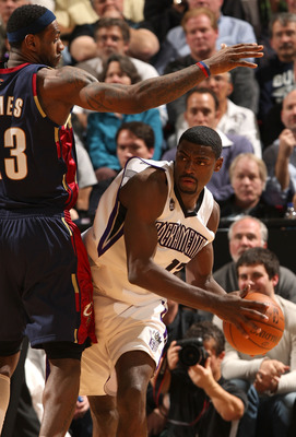SACRAMENTO, CA - DECEMBER 23:  Tyreke Evans #13 of the Sacramento Kings is defended by LeBron James #23 of the Cleveland Cavaliers during an NBA game at ARCO Arena on December 23, 2009 in Sacramento, California.  NOTE TO USER: User expressly acknowledges