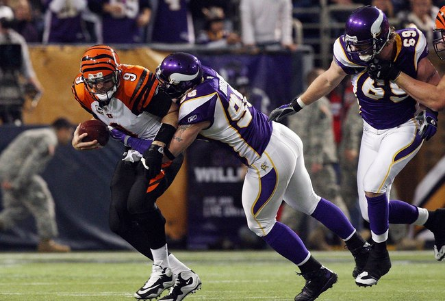 MINNEAPOLIS, MN - DECEMBER 13:  Carson Palmer #9 of the Cincinnati Bengals is sacked by Brian Robison #96 of the Minnesota Vikings on December 13, 2009 at Hubert H. Humphrey Metrodome in Minneapolis, Minnesota. (Photo by Elsa/Getty Images)  (Photo by Jim