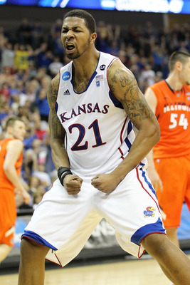 TULSA, OK - MARCH 20:  Markieff Morris #21 of the Kansas Jayhawks celebrates after a dunk against the Illinois Fighting Illini during the third round of the 2011 NCAA men's basketball tournament at BOK Center on March 20, 2011 in Tulsa, Oklahoma.  (Photo