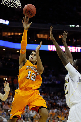 CHARLOTTE, NC - MARCH 18:  Tobias Harris #12 of the Tennessee Volunteers shoots over Tim Hardaway Jr. #10 of the Michigan Wolverines in the first half during the second round of the 2011 NCAA men's basketball tournament at Time Warner Cable Arena on March