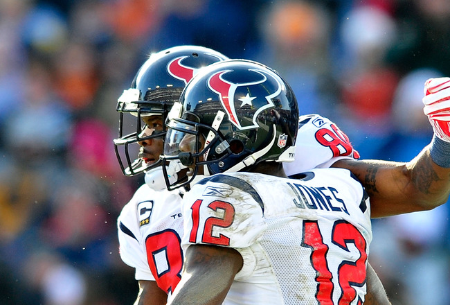 NASHVILLE, TN - DECEMBER 19:  Andre Johnson #80 and Jacoby Jones #12 of the Houston Texans celebrate after Johnson's touchdown against the Tennessee Titans at LP Field on December 19, 2010 in Nashville, Tennessee. The Titans defeated the Texans, 31-17.  (