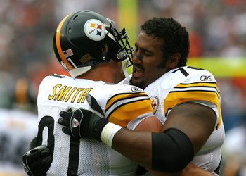 CHICAGO - SEPTEMBER 20: Max Starks #78 of the Pittsburgh Steelers hugs teammate Aaron Smith #91 before a game against the Chicago Bears on September 20, 2009 at Soldier Field in Chicago, Illinois. The Bears defeated the Steelers 17-14. (Photo by Jonathan
