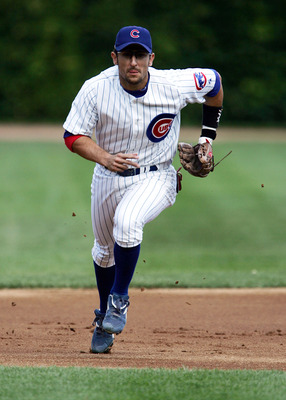 CHICAGO - AUGUST 27:  Nomar Garciaparra #5 of the Chicago Cubs charges toward home plate from his third base position against the Florida Marlins on August 27, 2005 at Wrigley Field in Chicago, Illinois. The Marlins defeated the Cubs 2-1.  (Photo by Jonat