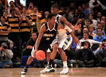 NEW YORK, NY - MARCH 08: Marshon Brooks #2 of the Providence Friars dribbles the ball against Jimmy Butler #33 of the Marquette Golden Eagles during the first round of the 2011 Big East Men's Basketball Tournament presented by American Eagle Outfitters at