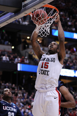 ANAHEIM, CA - MARCH 24:  Kawhi Leonard #15 of the San Diego State Aztecs dunks the ball against the Connecticut Huskies during the west regional semifinal of the 2011 NCAA men's basketball tournament at the Honda Center on March 24, 2011 in Anaheim, Calif
