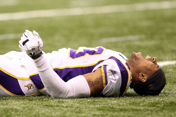 NEW ORLEANS - JANUARY 24:  Cedric Griffin #23 of the Minnesota Vikings reacts after getting injured during the NFC Championship Game at the Louisiana Superdome on January 24, 2010 in New Orleans, Louisiana.  (Photo by Ronald Martinez/Getty Images)
