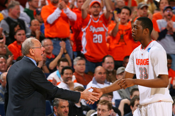 BUFFALO, NY - MARCH 21:  Head coach Jim Boeheim of the Syracuse Orange greets DaShonte Riley #33 as he comes out of the game against the Gonzaga Bulldogs during the second round of the 2010 NCAA men's basketball tournament at HSBC Arena at HSBC Arena on M