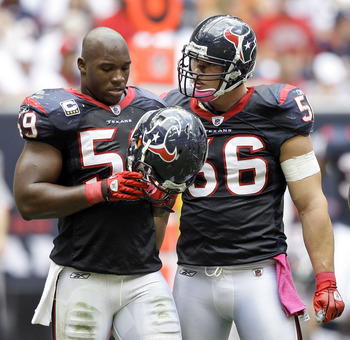 HOUSTON - OCTOBER 17:  DeMeco Ryans #59 and Brian Cushing #56 of the Houston Texans talk during a break in the play during  a game against the Kansas City Chiefs at Reliant Stadium on October 17, 2010 in Houston, Texas.  (Photo by Bob Levey/Getty Images)