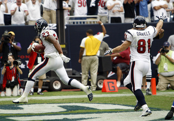 HOUSTON - SEPTEMBER 12:  Running back Arian Foster #23 of the Houston Texans  struts into the endzone for a score in the fourth quarter against the Indianapolis Colts during the NFL season opener at Reliant Stadium on September 12, 2010 in Houston, Texas.