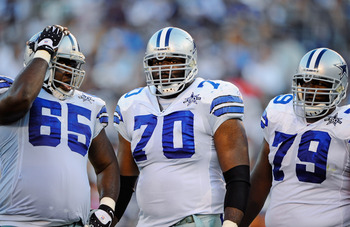 SAN DIEGO - AUGUST 21:  Andre Gurode #65, Leonard Davis #70 and Robert Brewster #79 of the Dallas Cowboys in action during the pre-season NFL football game against San Diego Chargers at Qualcomm Stadium on August 21, 2010 in San Diego, California.  (Photo